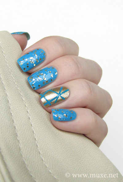Blue nails with gold design