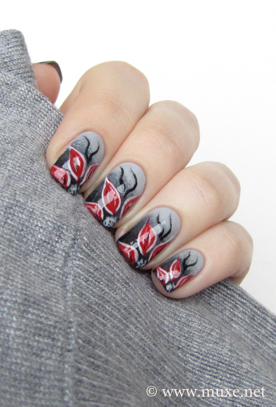 Flowers on grey nail design