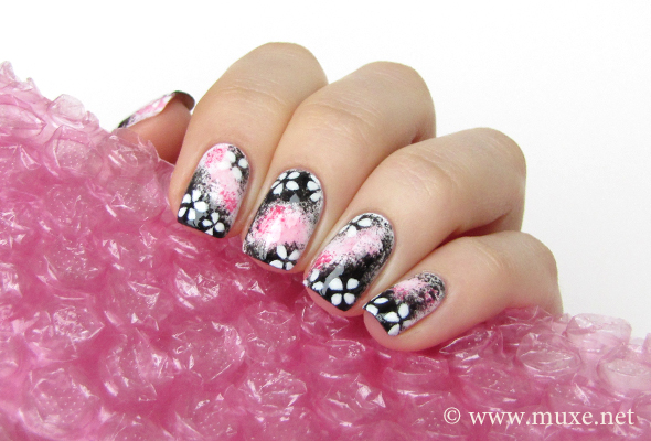 Black sakura flowers on nails