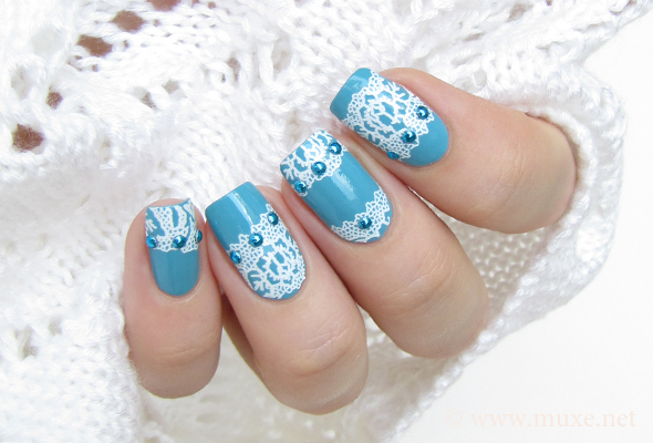 Blue nails with white lace and studs