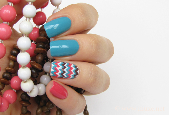 Chevron nail design in teal and white