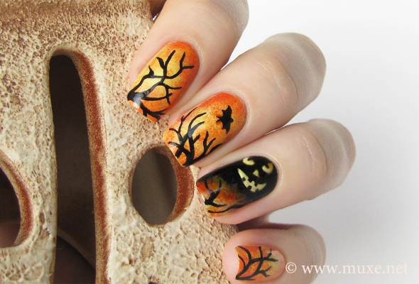 Halloween nails in orange and black