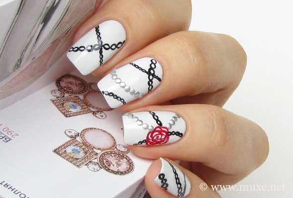 Goth nail art with silver studs