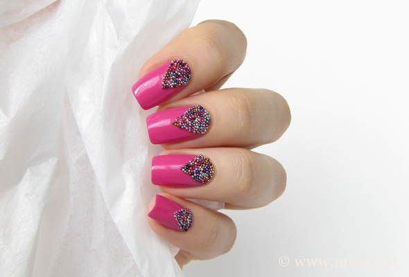 Pink nails with colorful microbeads