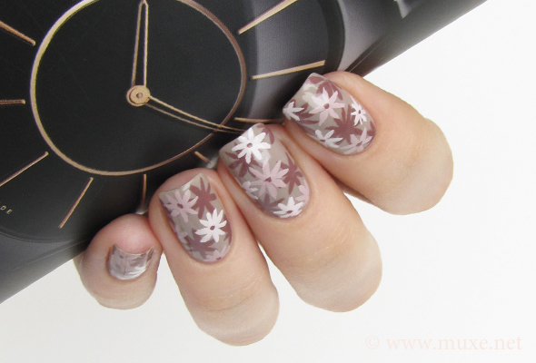 Floral nail art on beige and white