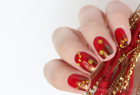 red nail designs with red rhinestones