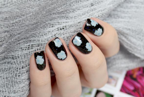 White roses on black nails