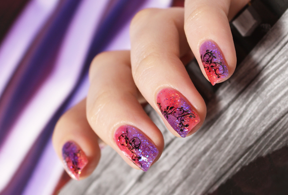 Pink purple nail design with flowers
