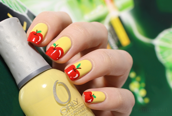 Red apple nail design on yellow