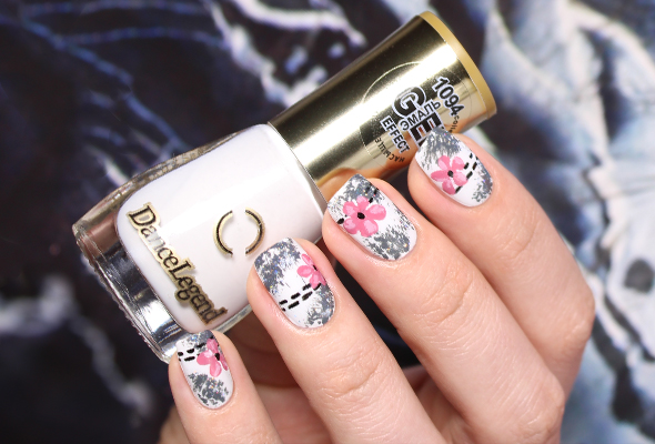 Pink floral nail design on white