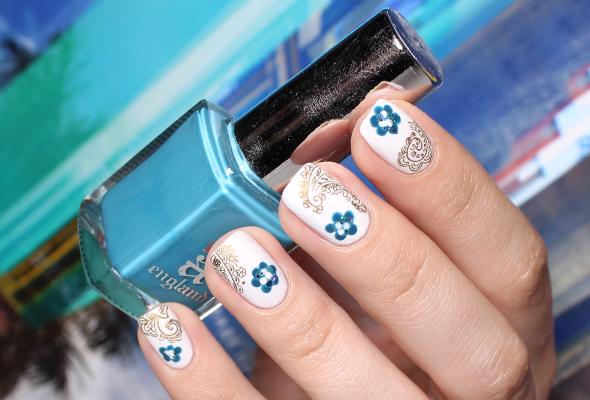 Teal flowers on white nail design