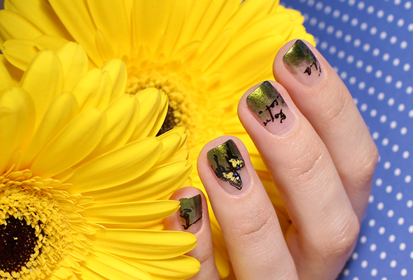 Butterfly nail art in green and yellow